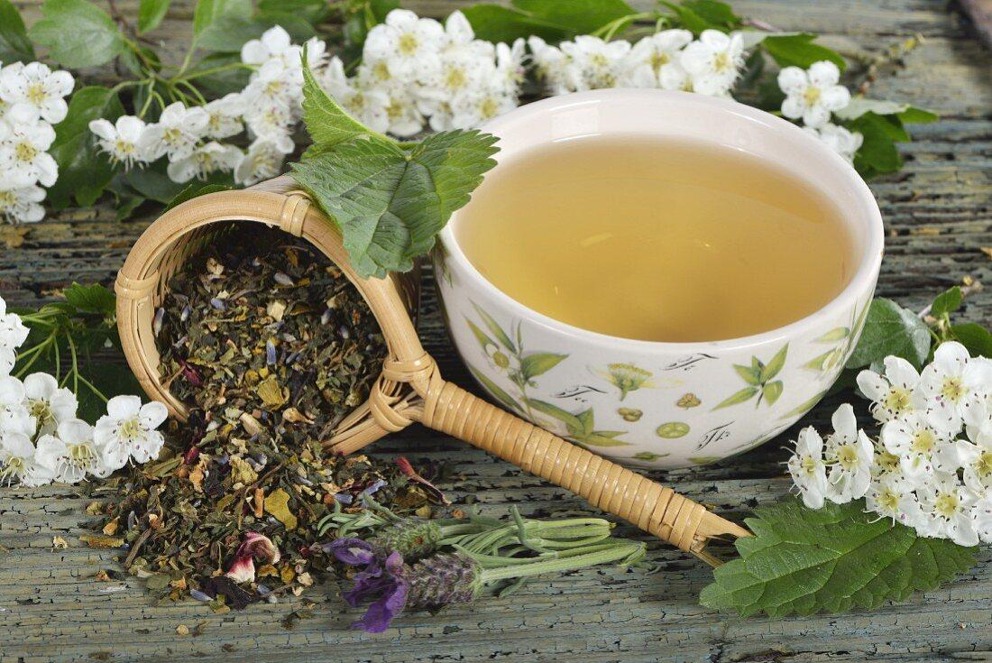 Herbal tea and tea leaves (mistletoe, hawthorn leaves, stinging nettle, valerian, hibiscus flowers and lavender)