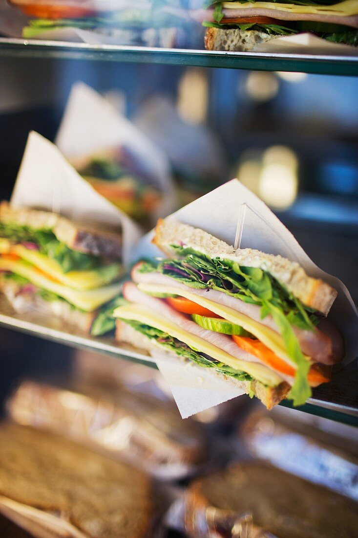 Various sandwiches on a display in a cafeteria