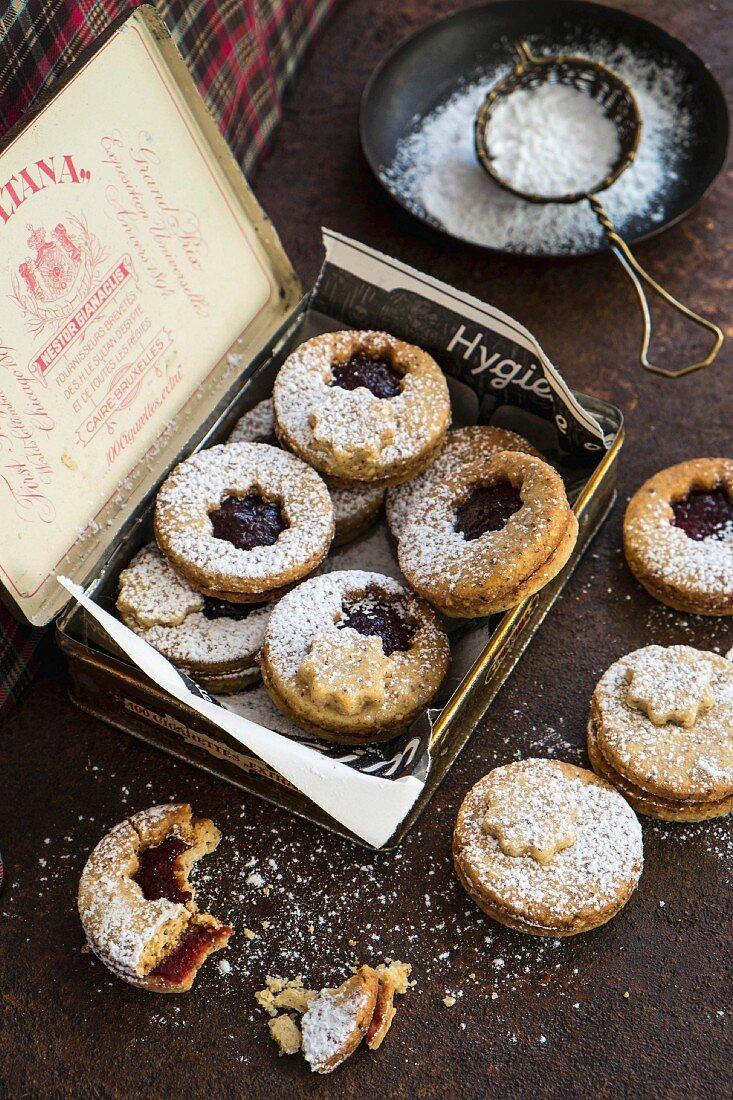 Linzer Plätzchen (nutty shortcrust jam sandwich biscuits with holes on top) in a gift box