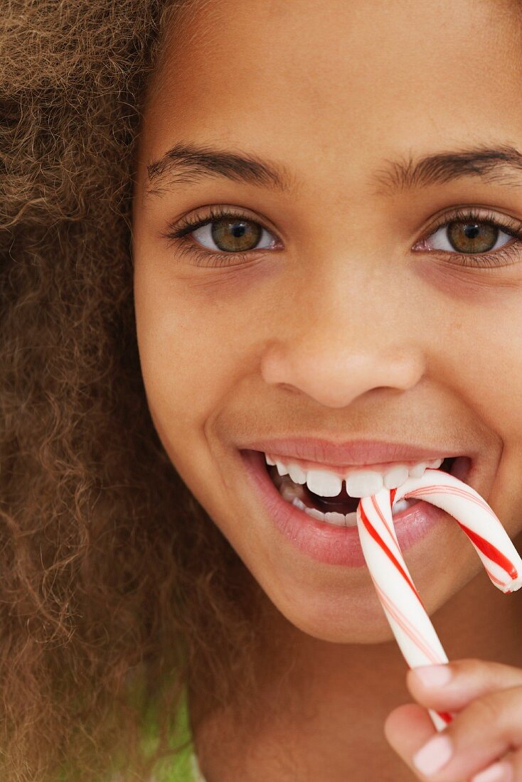 Girl eating candy stick