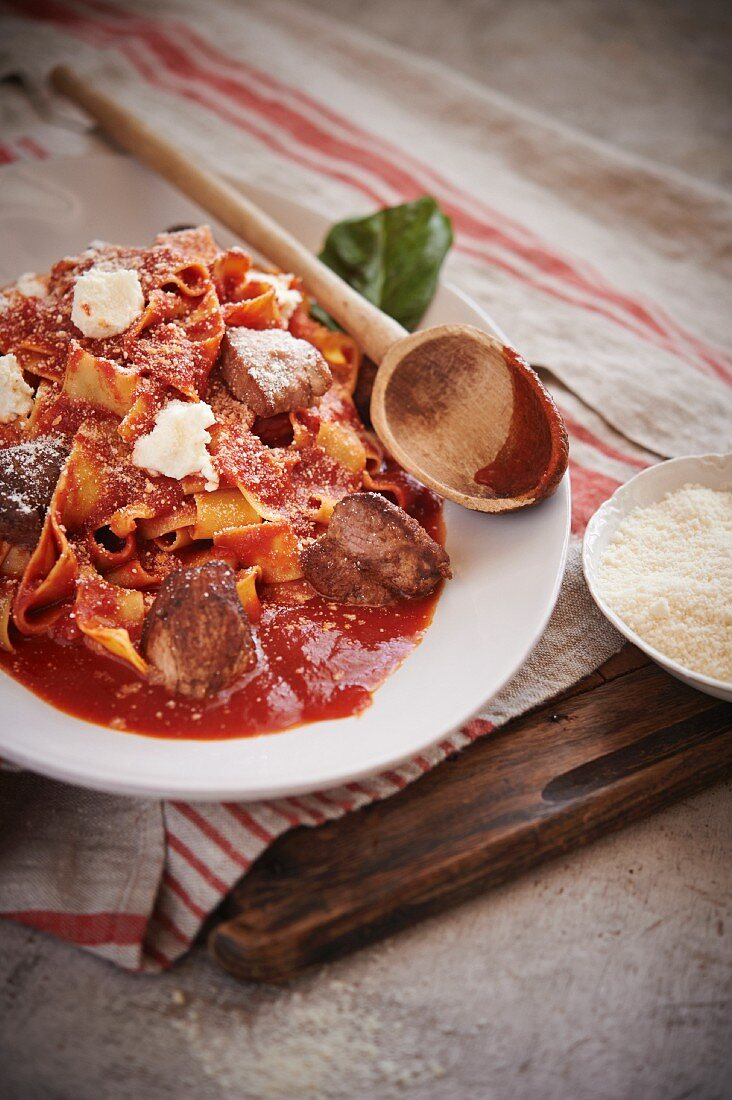 Pappardelle pasta with short rib ragu, made from roasted pork bones, tomatoes, herbs and spices.