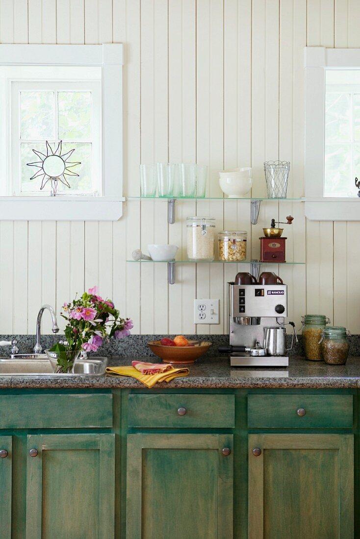 Rustic kitchen with espresso machine and storage jars