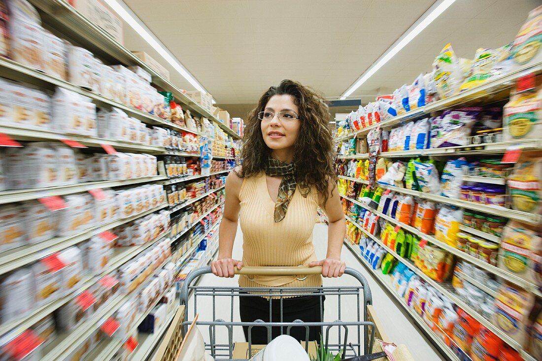 Hispanic woman shopping in grocery store