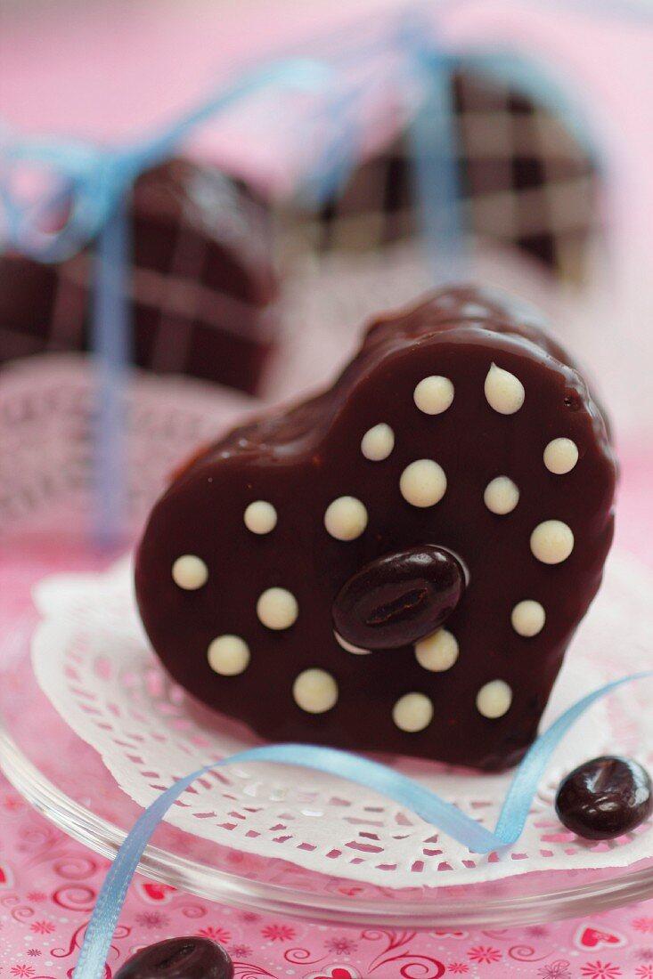 Individual mocha cream cake in the shape of a heart