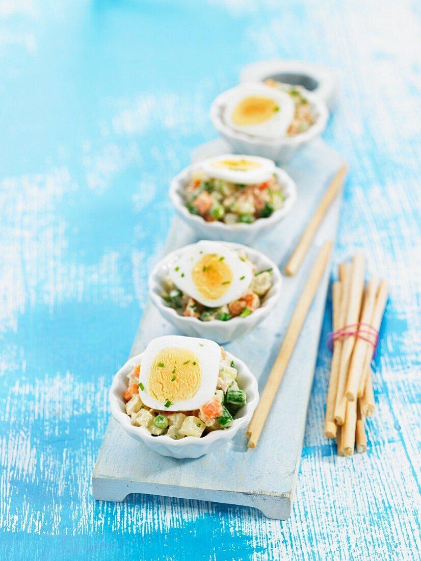Vegetable mayonnaise salad with hard-boiled egg