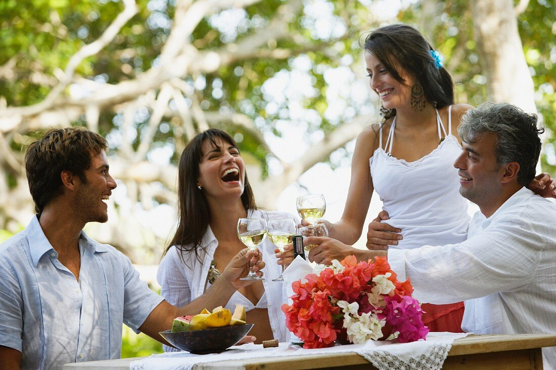 South American couples toasting with wine