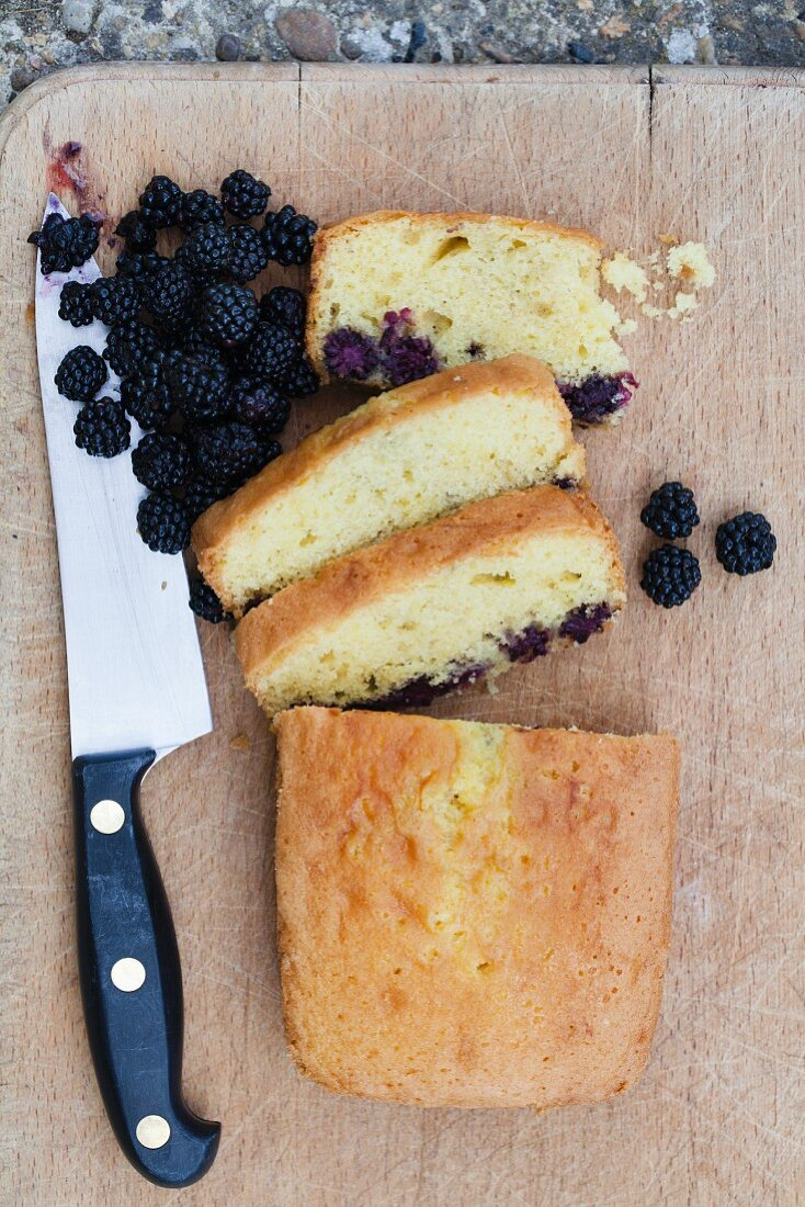 Blackberry cake on a chopping board (view from above)