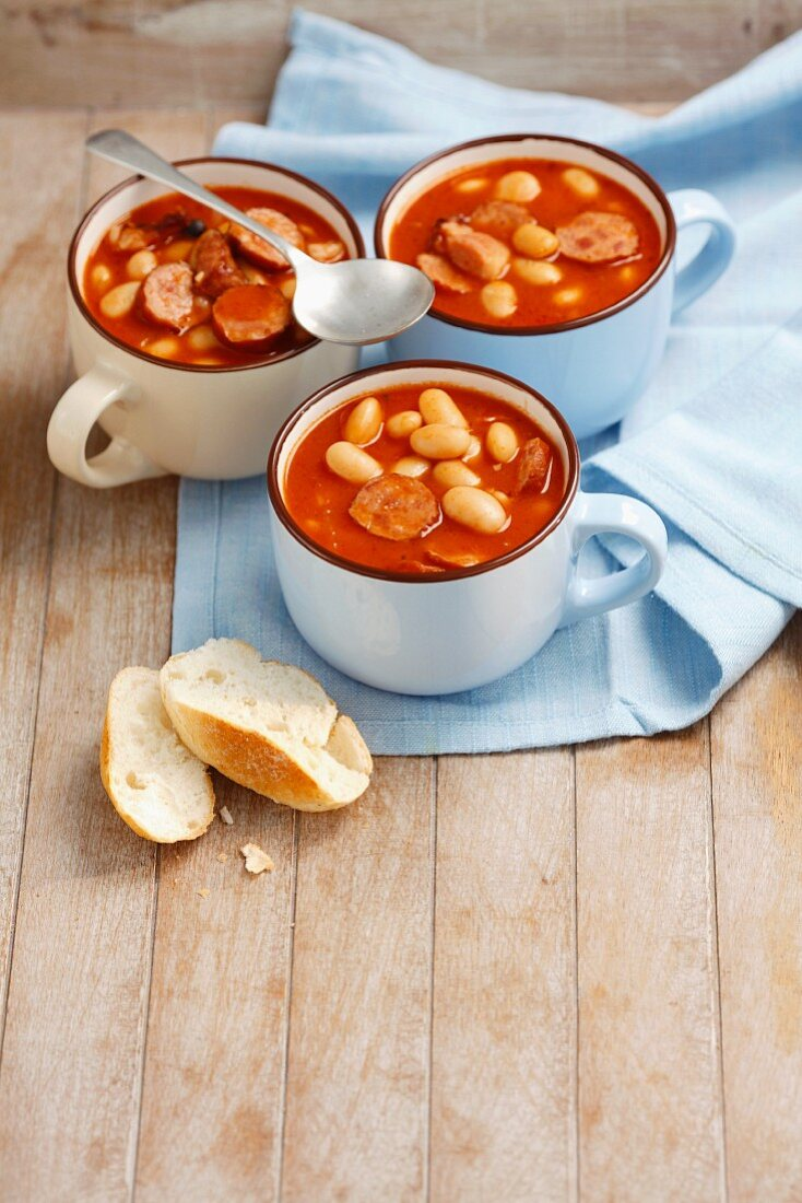 Beans with sausage and bacon in tomato sauce