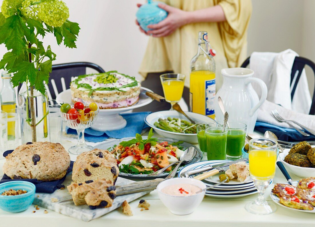 Vegetarian buffet with olive bread, melon salad, asparagus, sandwich cake and drinks