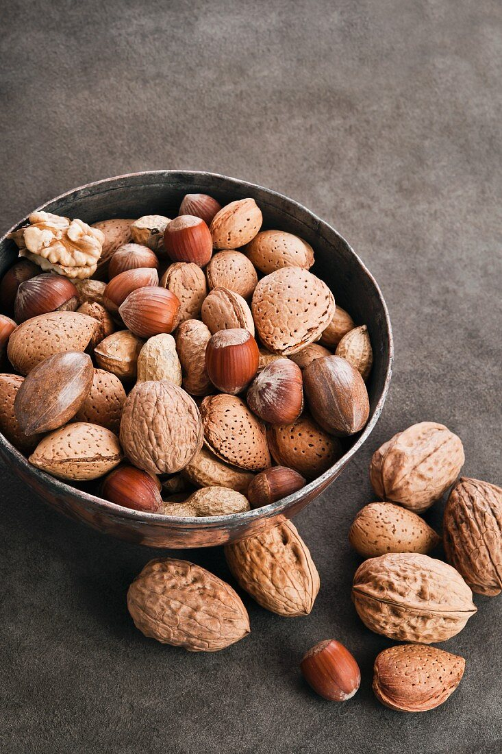Assorted nuts in a metal bowl