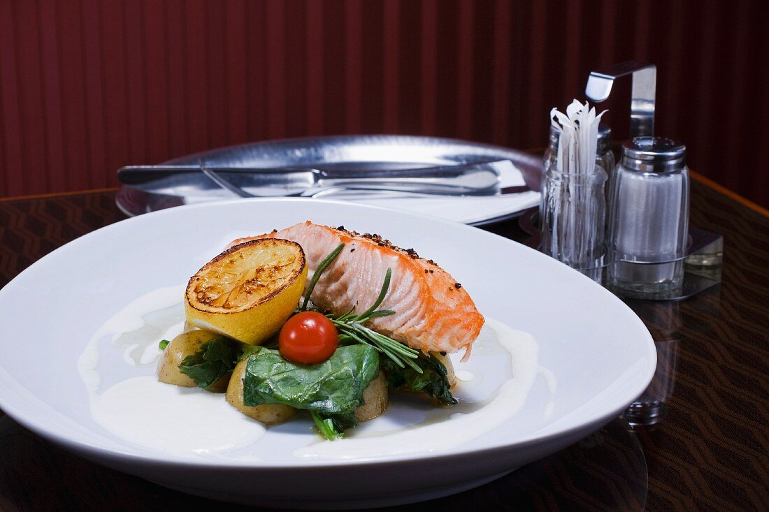 Grilled salmon with potatoes and spinach