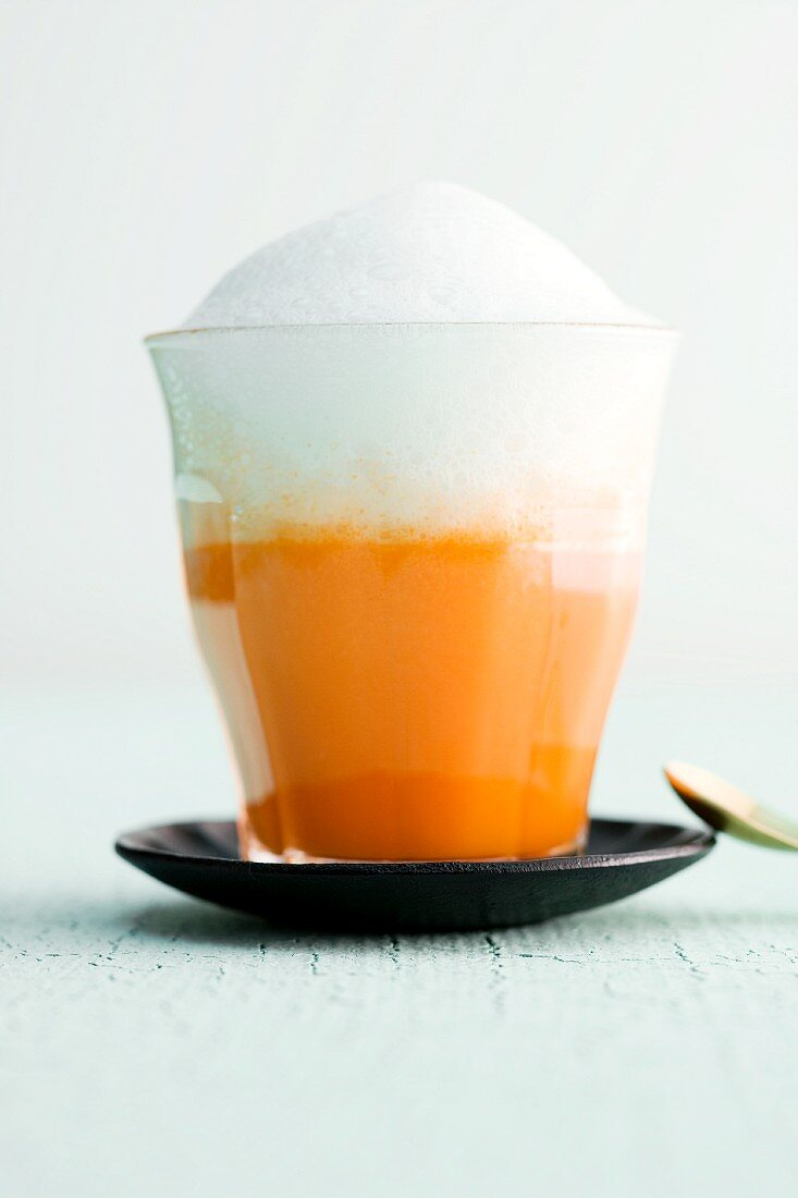 A carrot and orange cappuccino