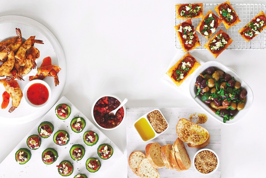 Finger Food - Wonton prawns, Greek salad cucumber cups, Chorizo and gremolata tartlets, Baked chilli and garlic olives, Dukkah with crusty bread