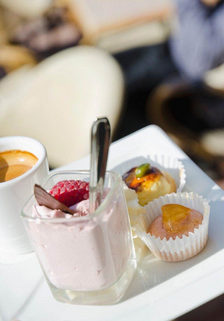 A selection of desserts with coffee on a porcelain plate