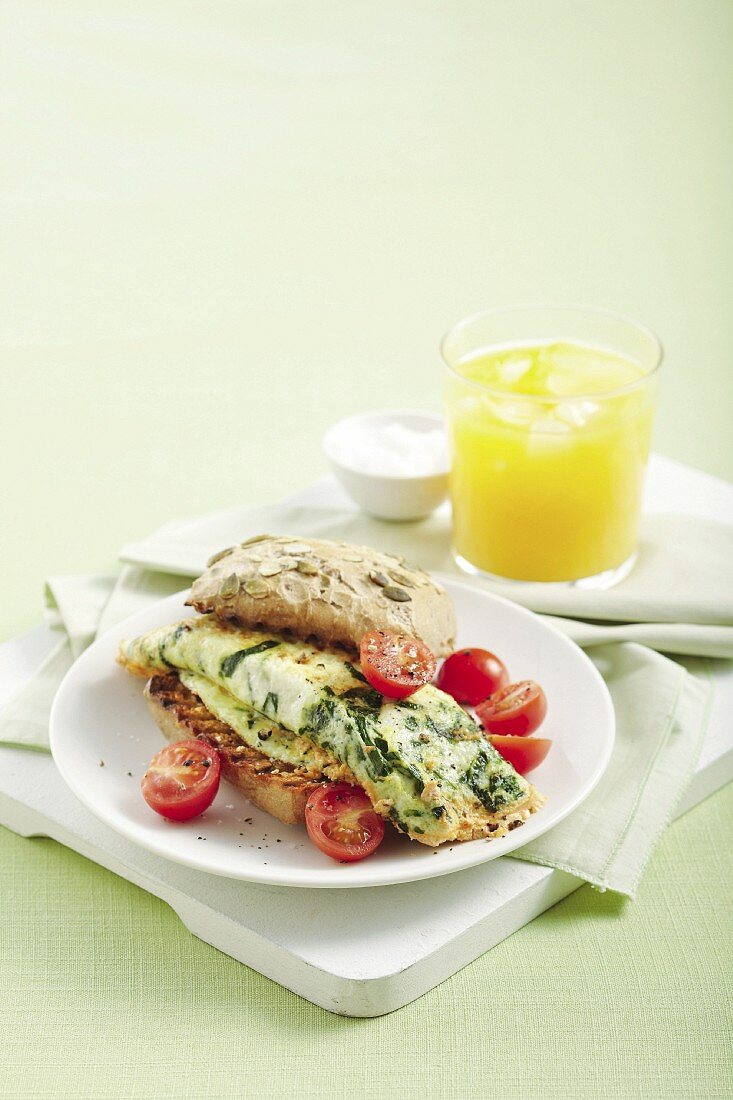 An egg white omelette with spinach and ricotta on a whole-grain roll