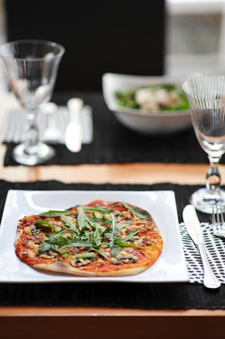 A mushroom and rocket pizza