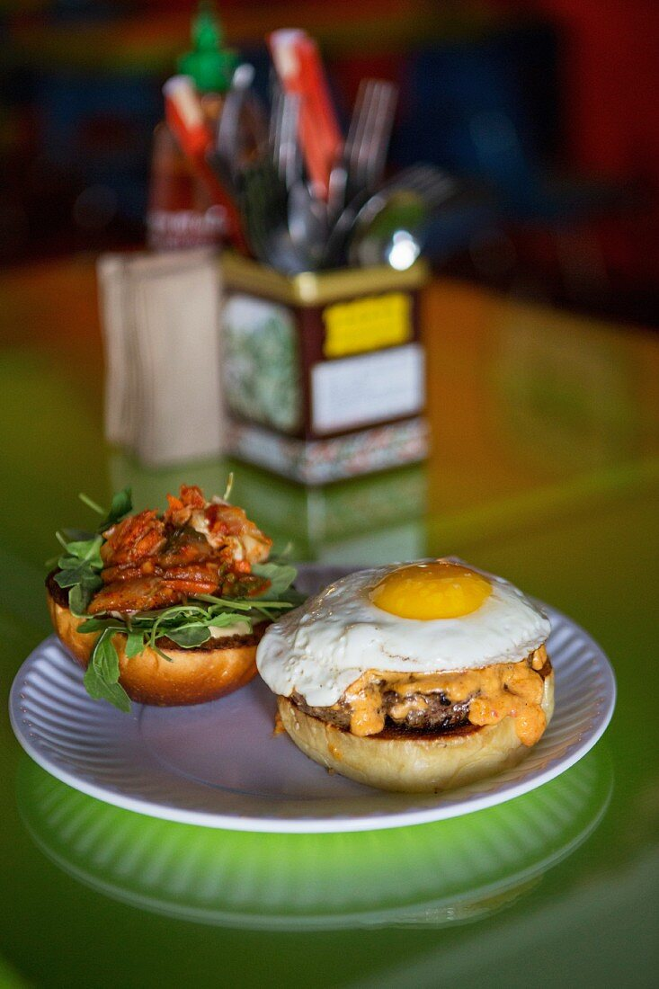 A hamburger and a fried egg