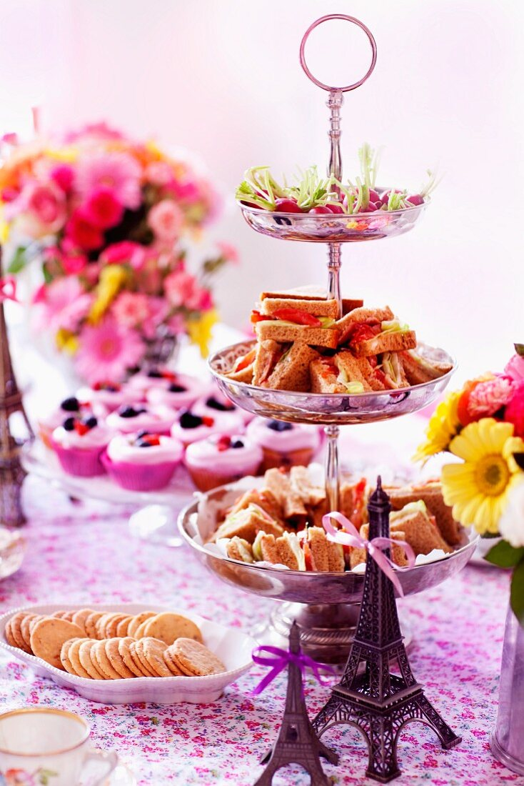 Mini sandwiches, biscuits and cupcakes for teatime