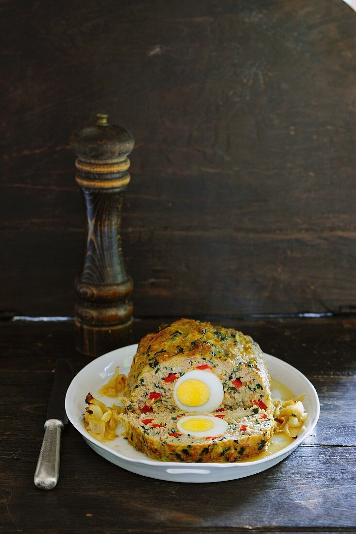 Colourful, vegetarian meatloaf with rice, vegetables and boiled egg