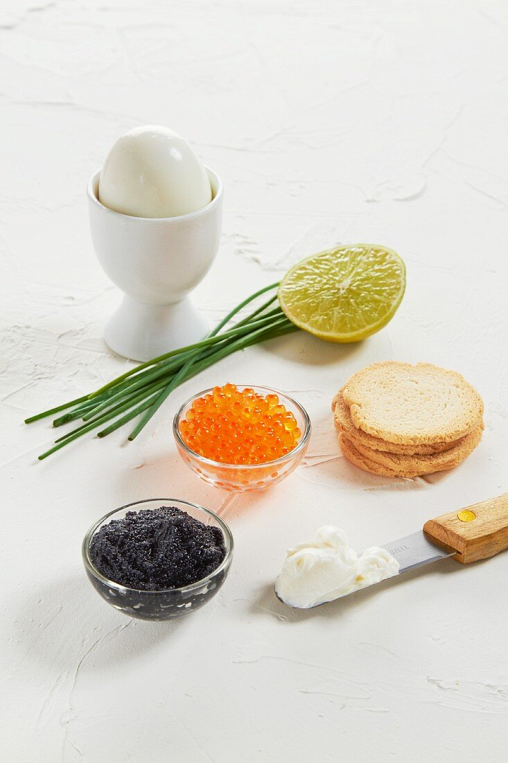 Caviar, a boiled egg, chives, lime, crackers and cream cheese