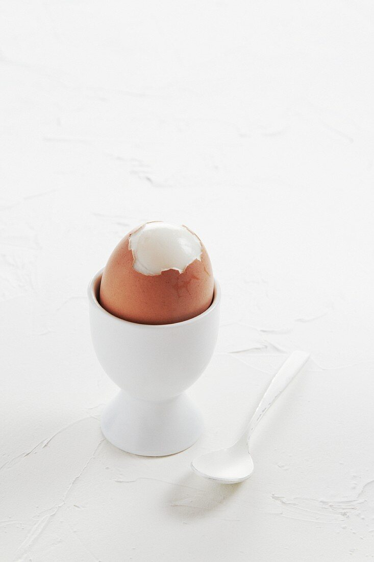 A hard-boiled egg in an egg cup