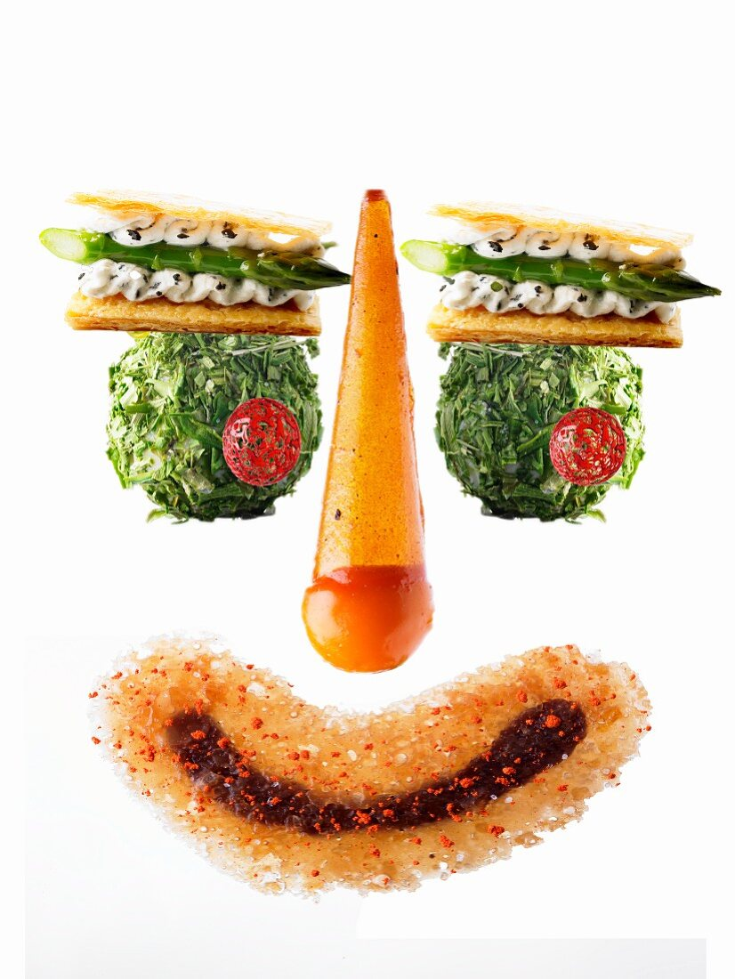 A funny face made from various amuse-bouche