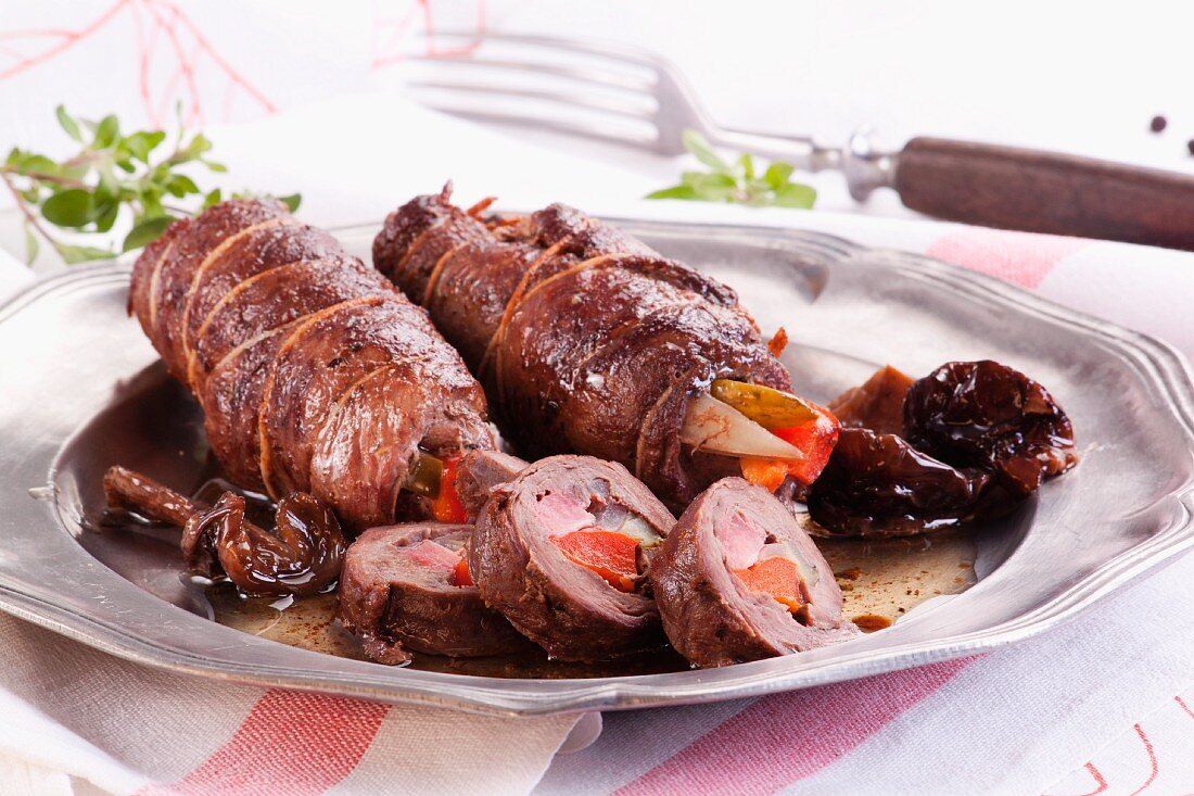 Goose roulade stuffed with peppers, gherkins and mushrooms