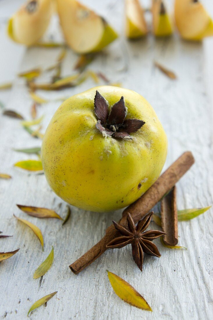 A quince, cinnamon sticks and star anise
