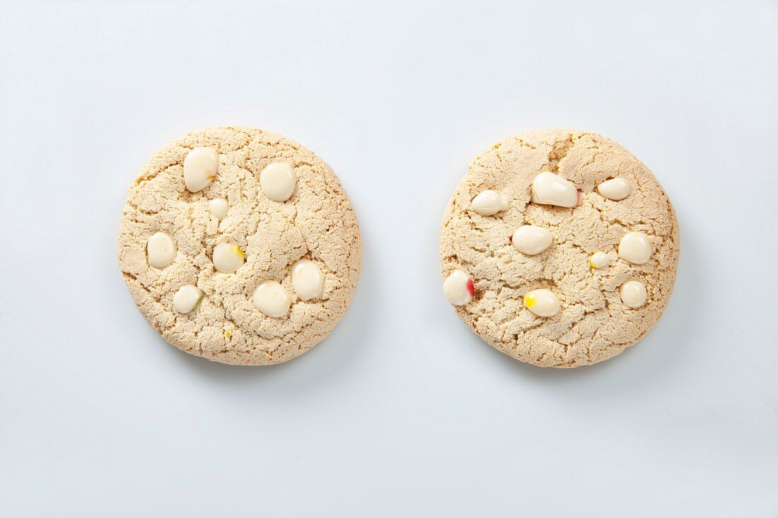 Two white chocolate chip cookies