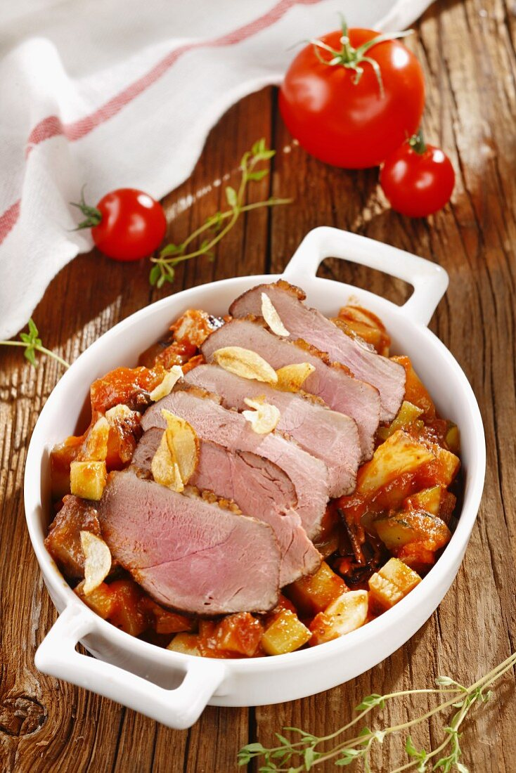 Roast pork with vegetables and garlic