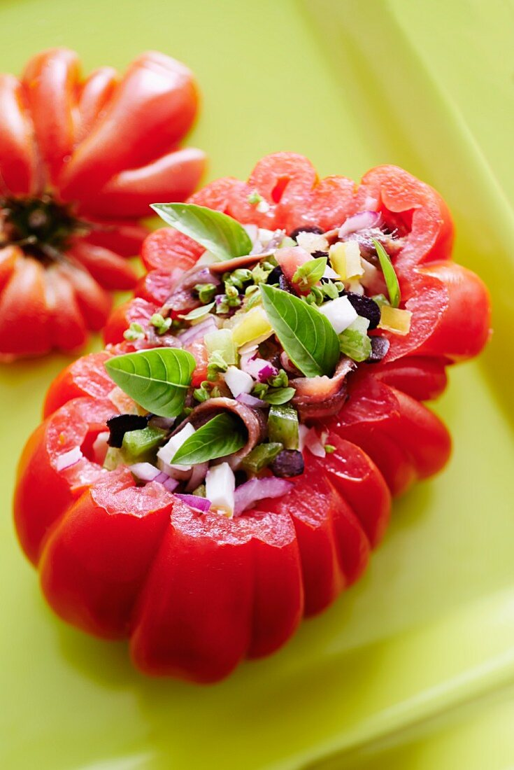 Stuffed beefsteak tomatoes with mozzarella and anchovies