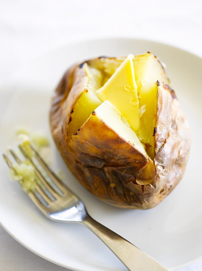 A jacket potato with butter