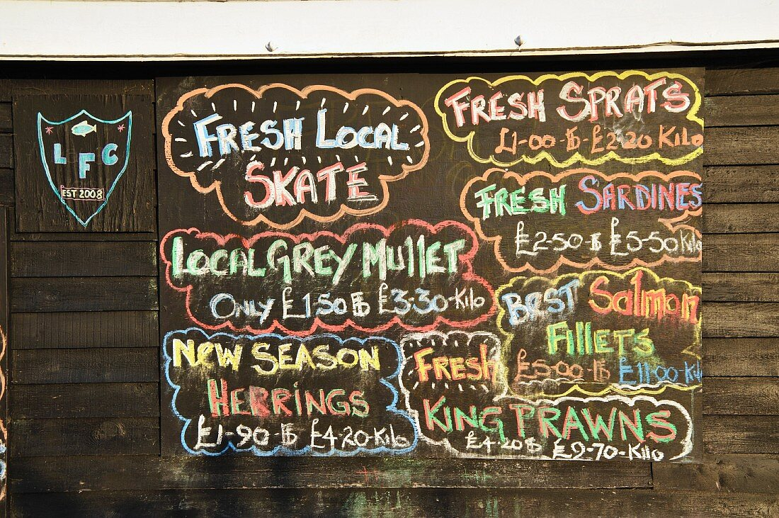 A price list with offers at a fish market