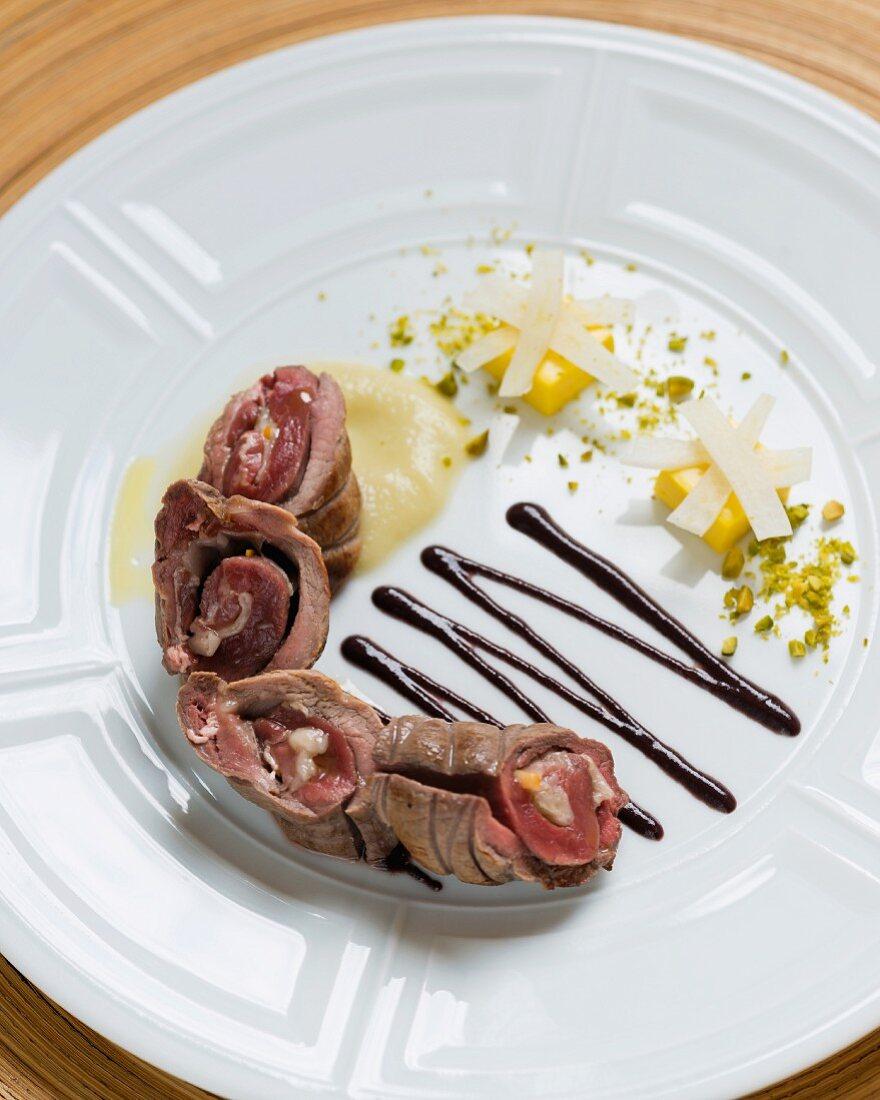Wild boar roulade with fennel, orange jelly and olive sauce (Restaurant Da Caino, Head Chef Valeria Piccini)