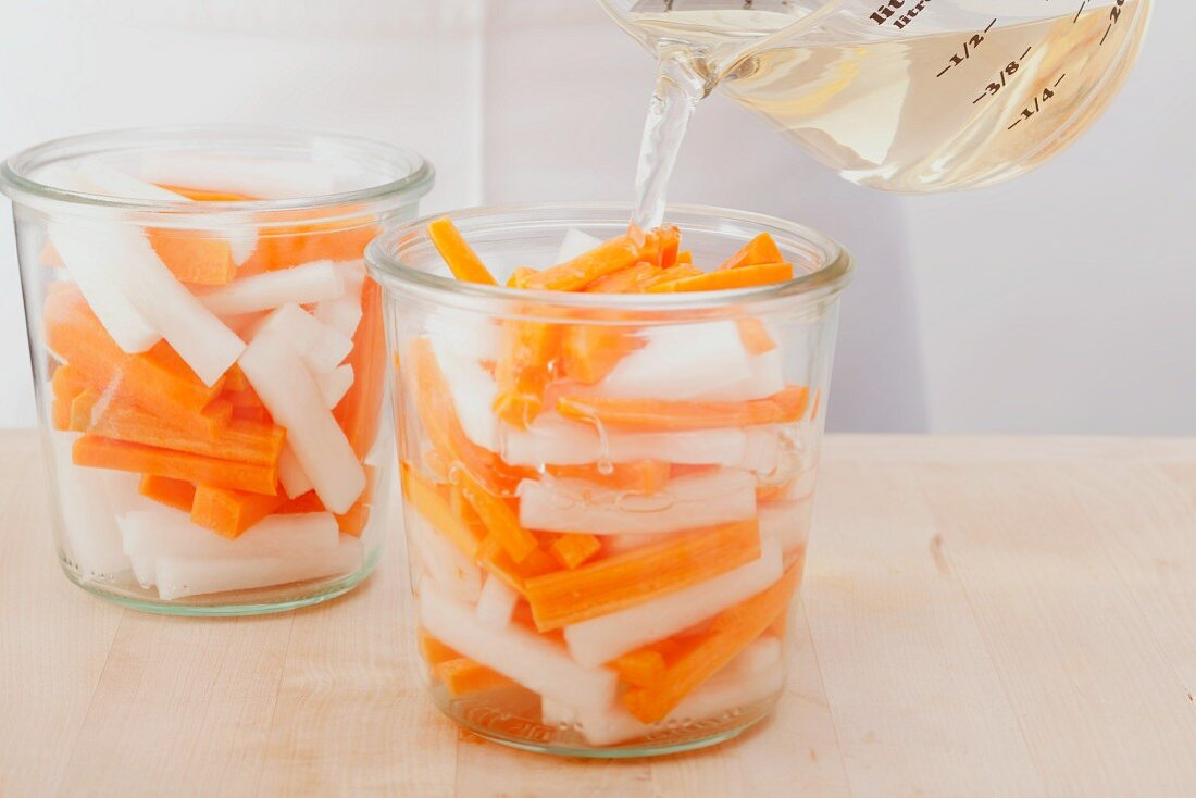 Radishes and carrots being pickled Vietnamese style