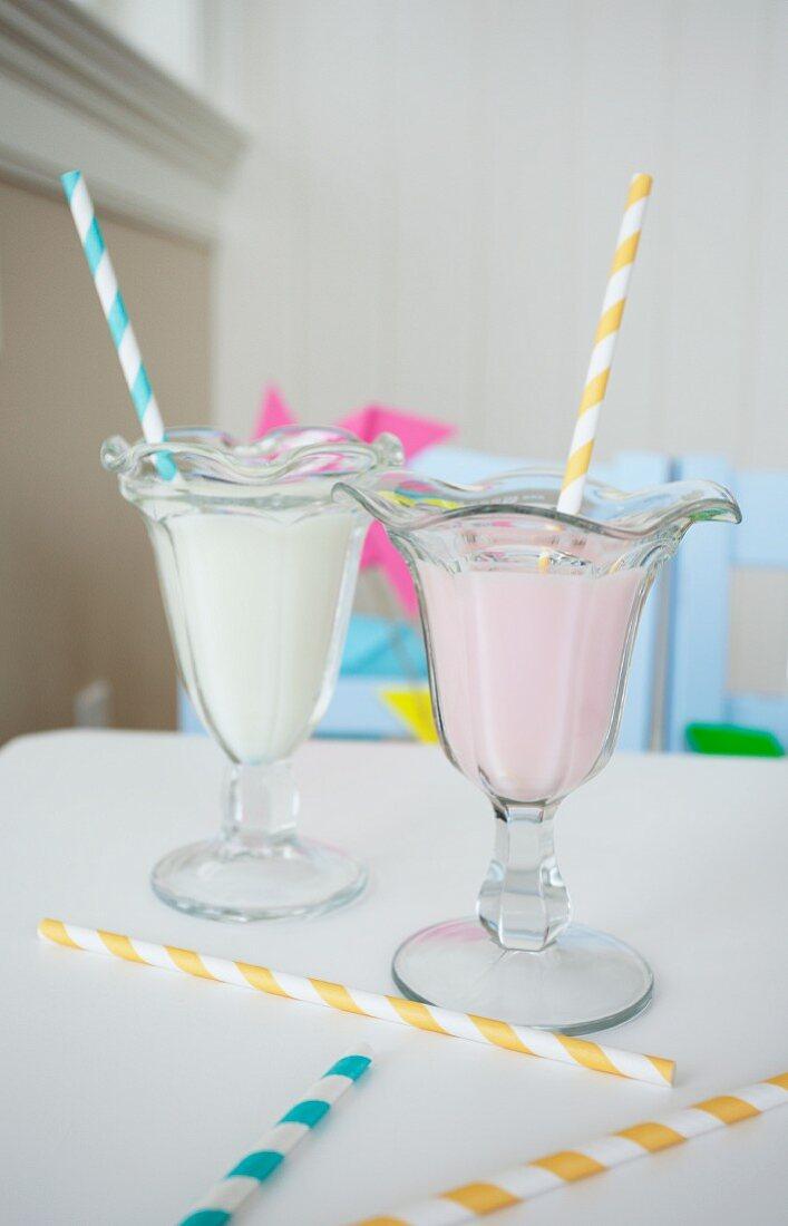 Two milkshakes with straws