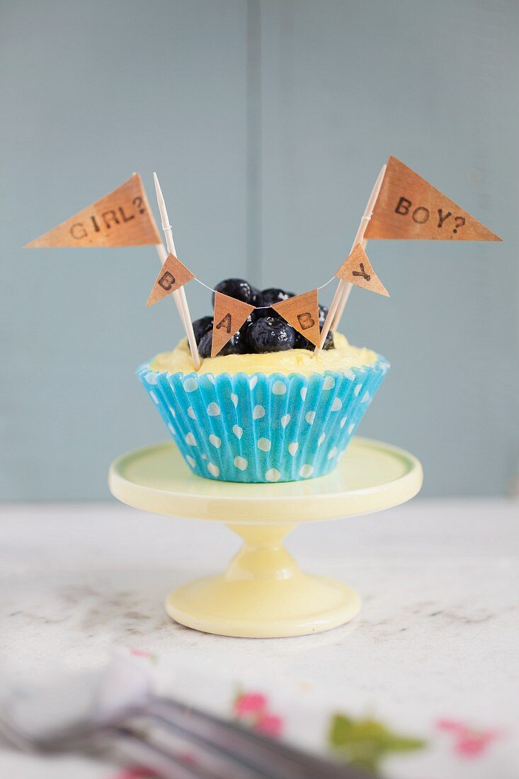 A lemon and blueberry cupcake for a baby shower