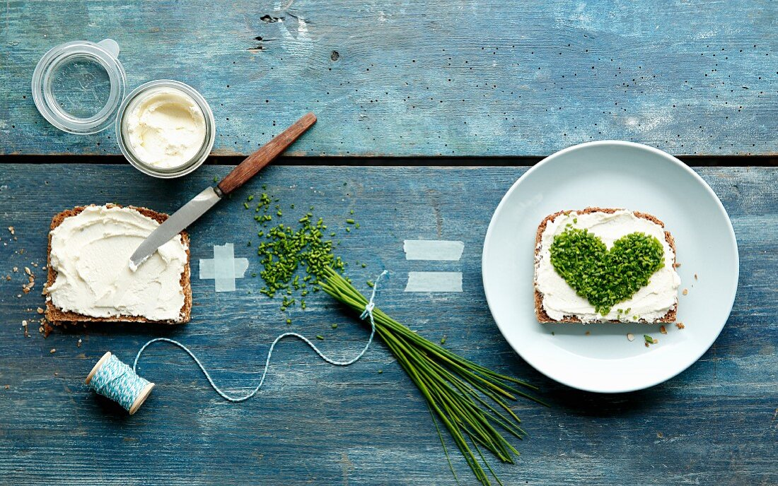 An equation showing how to make bread with cream cheese and a chive heart