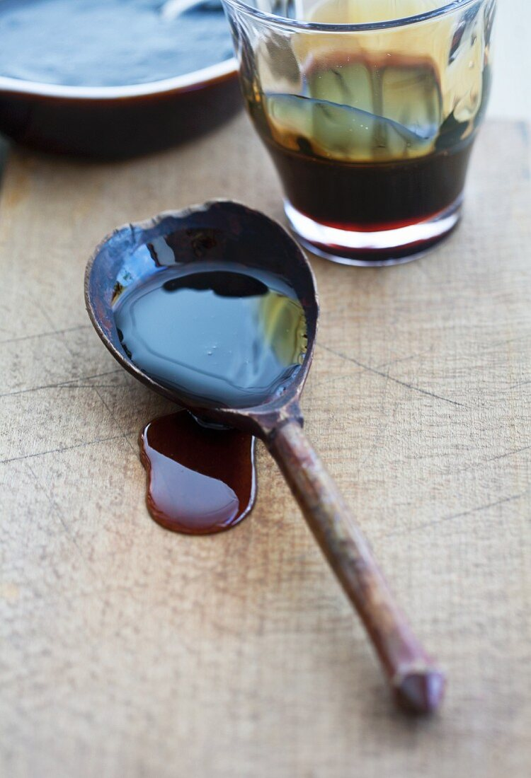 Sugar beet syrup dripping from a wooden spoon