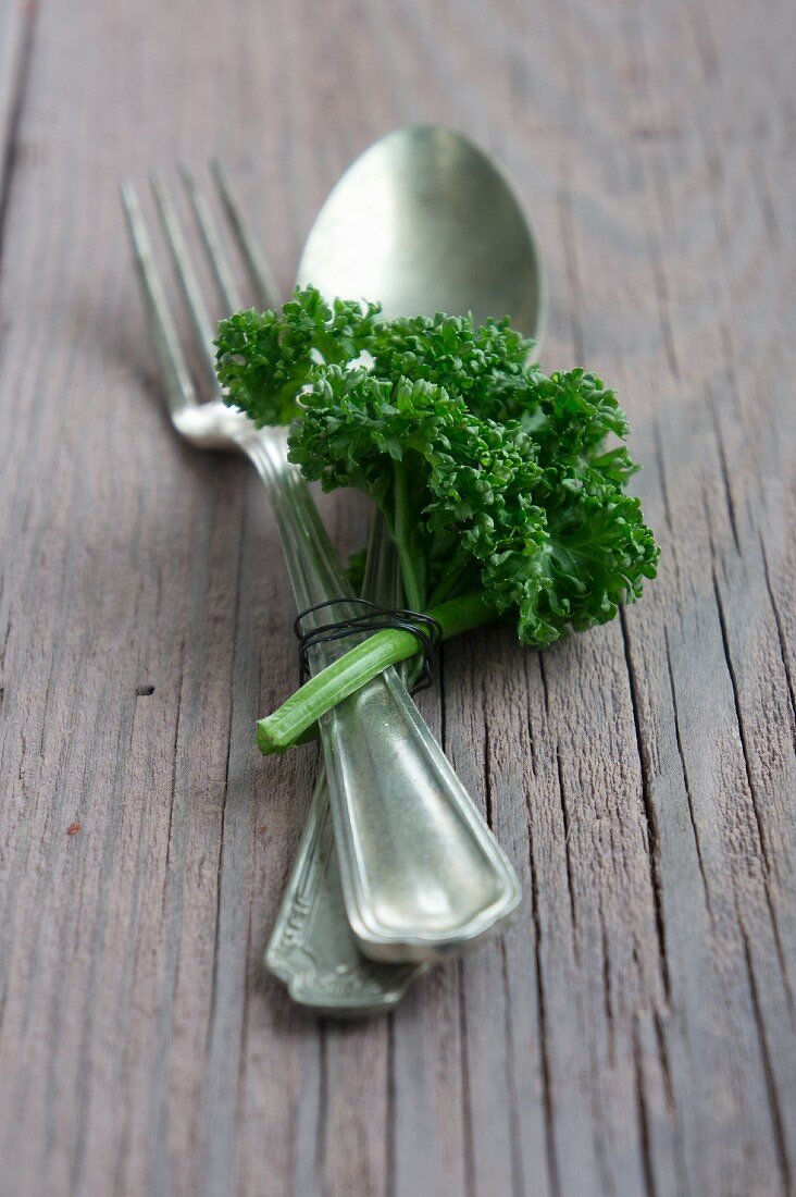 Cutlery decorated with a sprig of parsley
