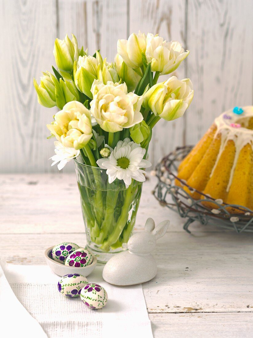 A bunch of tulips, Easter decorations and a baba