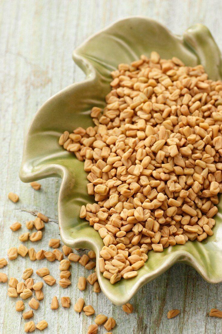 Fenugreek seeds in a leaf-shaped dish