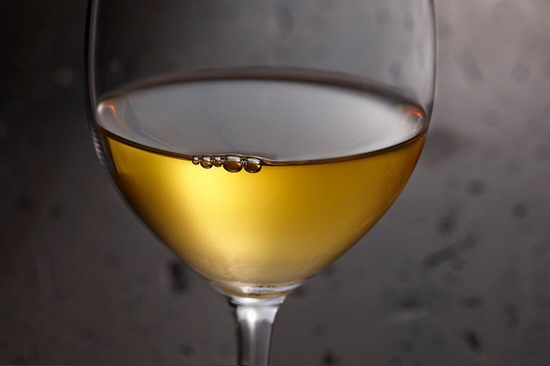 A glass of white wine (detail)