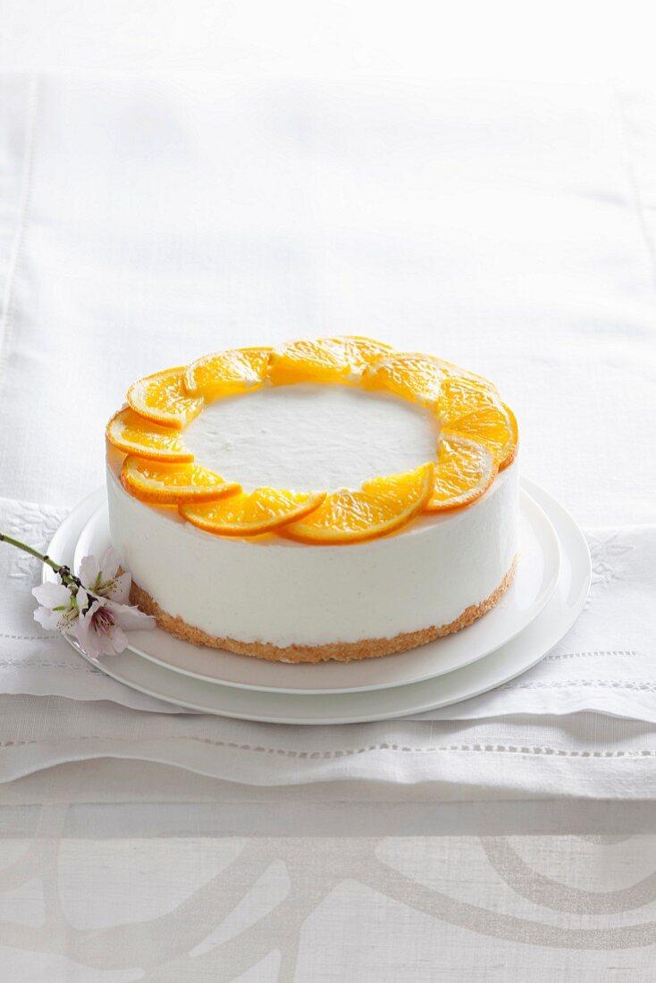 Citrus fruit and coconut pana cotta with orange slices