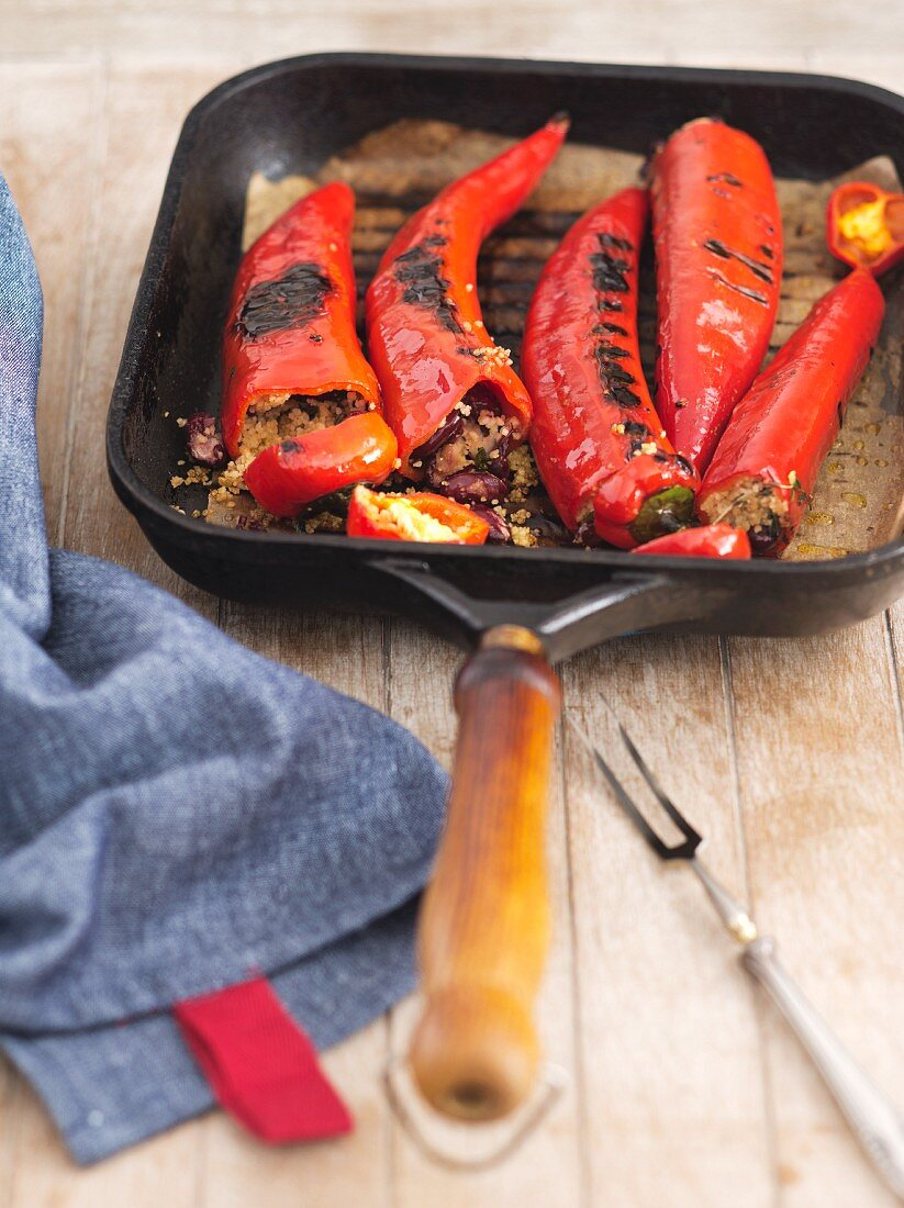 Stuffed, grilled chillis in a gill pan