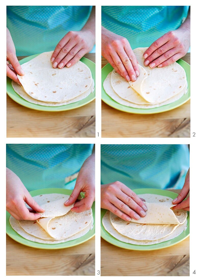Wraps being made: tortilla being rolled up