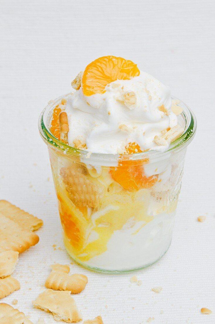 Frozen yogurt with mandarins and biscuits