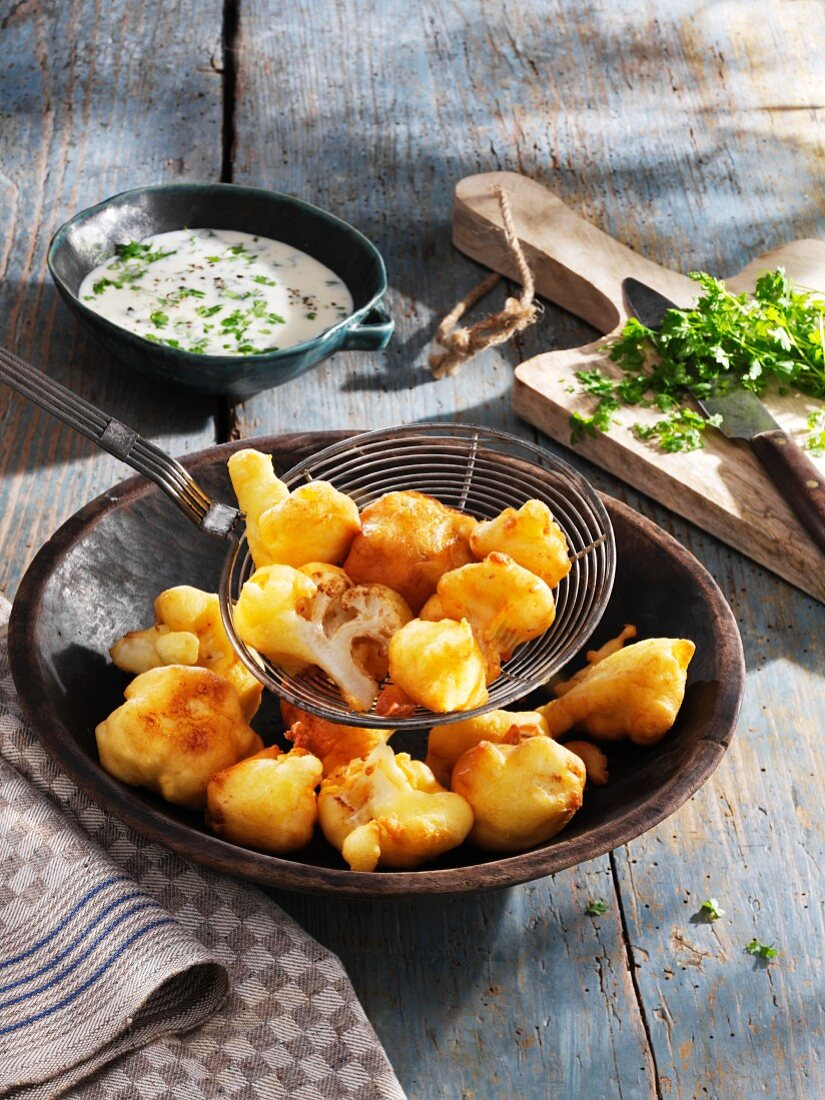 Cauliflower florets in a Parmesan coating with chervil sauce