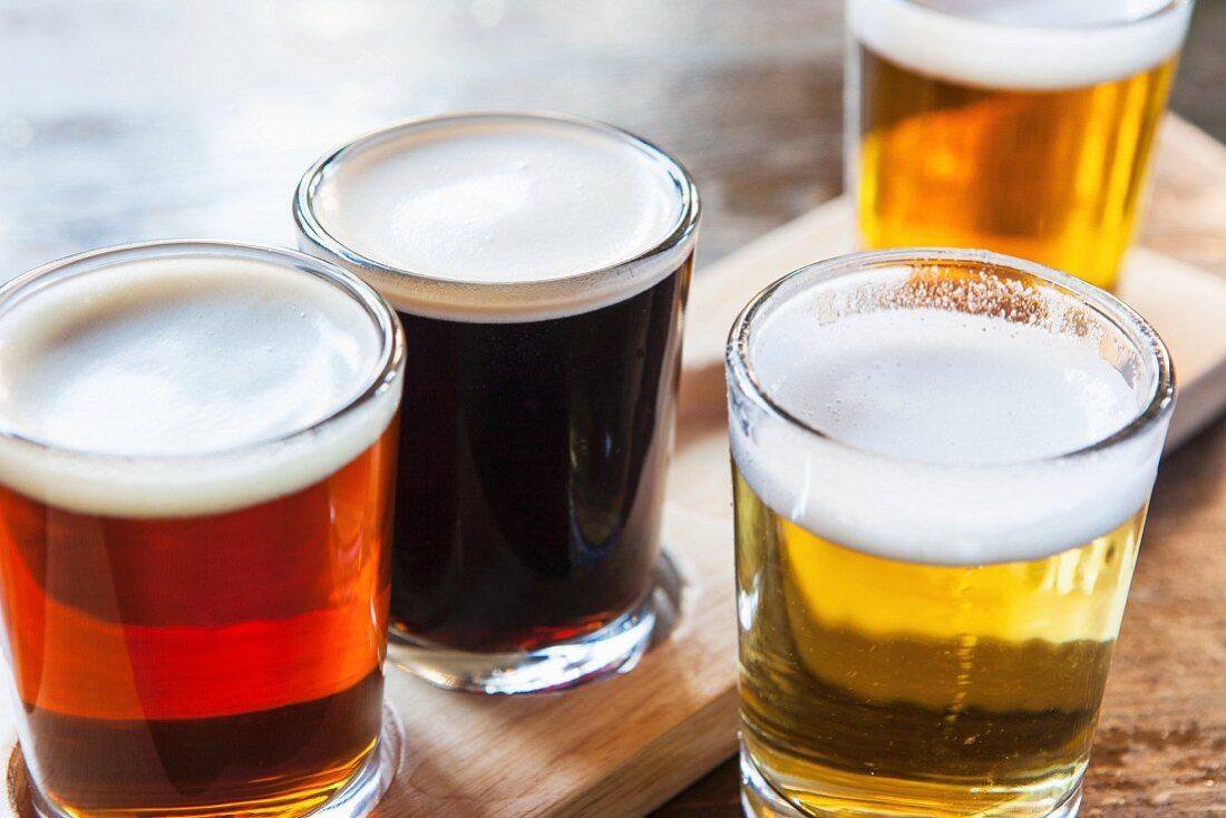 Various glasses of beer in a pub