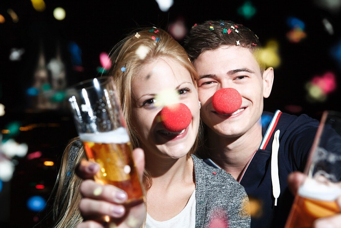 A happy couple with clown's noses